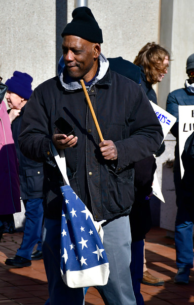 1/26/2019 Mike Orazzi | Staff Hartford community activist Cornell Lewis while leading a protest Saturday morning in downtown New Britain to protest the decision by an independent state's attorney to not charge five police officers who fired on a carload of men, killing Zoe Dowdell and wounding two others last December.