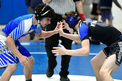 1/26/2019 Mike Orazzi | Staff Fairfield Ludlowe's Antonio Nicholas and Southington's Darius Mangiafico wrestle at Southington High School Saturday.