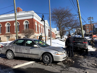 1/31/2019 Mike Orazzi | Staff The scene of a two vehicle crash at the intersection of Main and Summer Streets in Bristol Thursday afternoon. One was transported from the scene with injuries that were not life threatening.