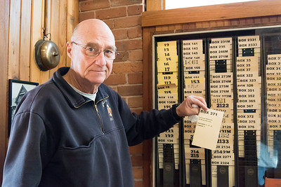 01/03/19  Wesley Bunnell | Staff  Retired Bristol Fire Department Lt. Mark Redman stands in front of a card system that would have been used in conjunction with fire alarm boxes to identify the location of an alarm and which fire assets would respond.
