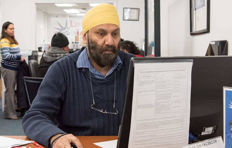 01/03/19  Wesley Bunnell   Staff  Office Manager Maninder (Raj) Arora works on a customers tax return at Liberty Tax Service at 291 Main St on Thursday afternoon.