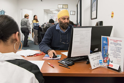01/03/19  Wesley Bunnell | Staff  Office Manager Maninder (Raj) Arora works on a customers tax return at Liberty Tax Service at 291 Main St on Thursday afternoon.