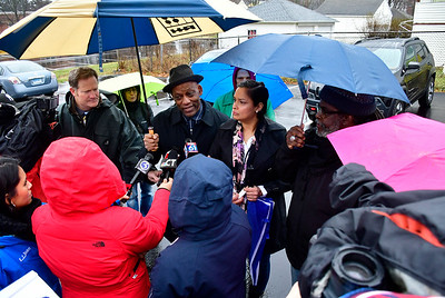 1/5/2019 Mike Orazzi | Staff Cornell Lewis and Gwen Cordero during a press conference on Chapman Street in New Britain more than a year after  five New Britain police officers shot and killed 20-year-old Zoe Dowdell last year. Police were justified in this use of deadly force, according to a report released by the Fairfield State's Attorney recently. Dowdell was fatally wounded while 15-year-old Caleb Tisdol and 18-year-old Noah Young were wounded. Young and Tisdol were later charged with committing robberies in New Britain. There were two guns in the vehicle when police fired, police said.