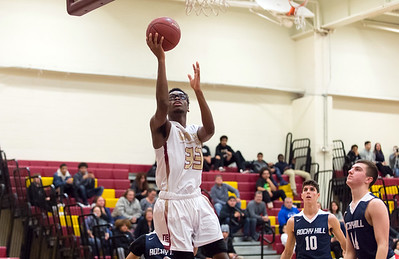 01/08/19  Wesley Bunnell | Staff  New Britain boys basketball defeated Rocky Hill in a home game on Tuesday night. Shamah Charles (33)