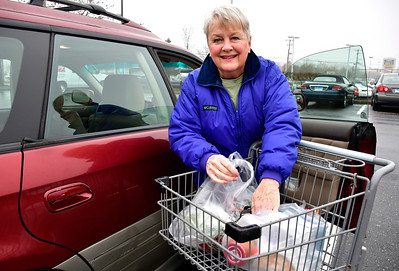 1/8/2019 Mike Orazzi | Staff Patte Slater of New Britain while loading plastic bags with groceries she bought at the Big Y in Plainville Tuesday. The store plans to eliminate plastic bags.
