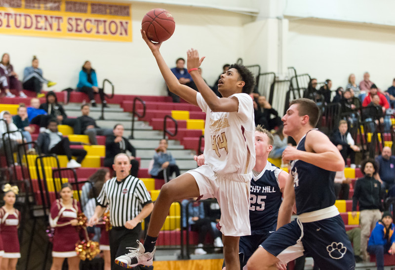 01/08/19  Wesley Bunnell   Staff  New Britain boys basketball defeated Rocky Hill in a home game on Tuesday night. David Quinones (44).
