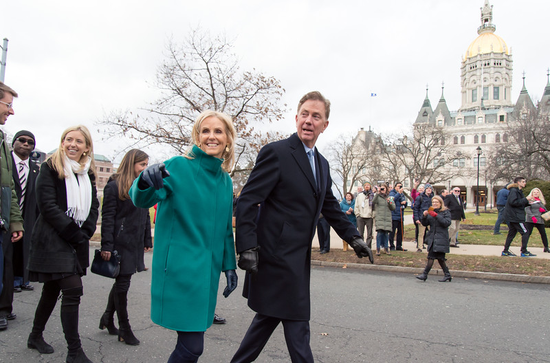01/09/19  Wesley Bunnell | Staff  Governor Ned Lamont and his wife Ann Lamont look over to acknowledge well wishers who lined the route during his inauguration parade.