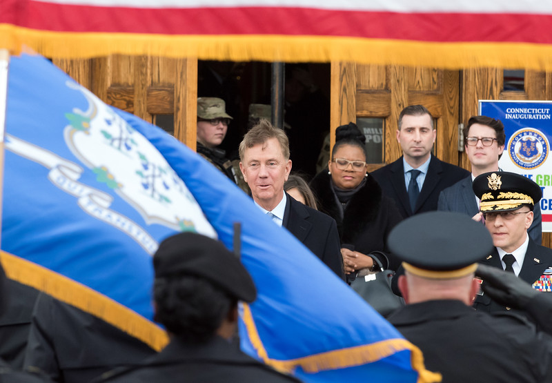 01/09/19  Wesley Bunnell | Staff  Governor Ned Lamont stands in front of the main entrance to the State Armory just prior to his parade.