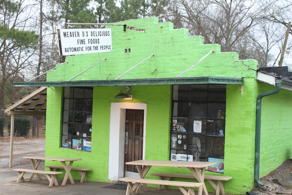 Green cinderblock building turned into a restaurant