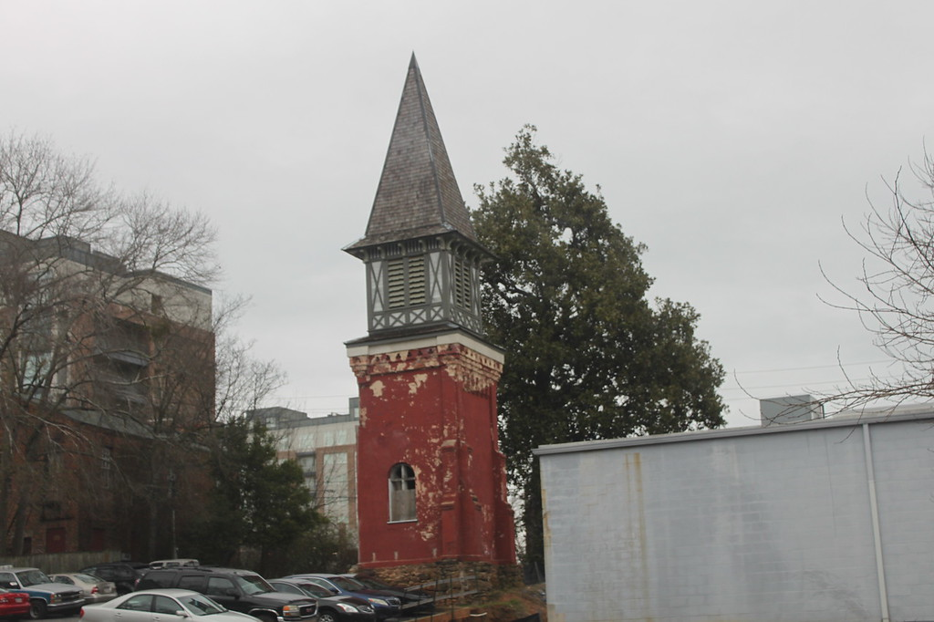 Crumbling church steeple in a parking lot
