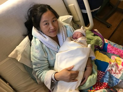 Tong Yang, of Thermalito, holds her new son, Matthew, Wednesday afternoon. Matthew was the first baby born in 2020 in Butte County. (Robin Epley -- Enterprise-Record)