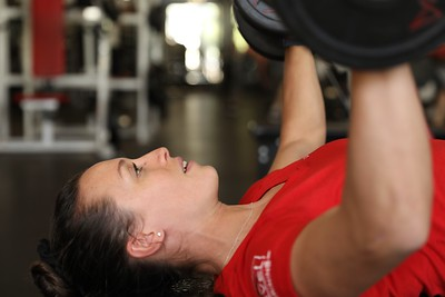 Carolyn Kurnizki, personal training lead at Chico Sports Club, does chest presses in the weight room on Dec. 31. (Carin Dorghalli -- Enterprise-Record)