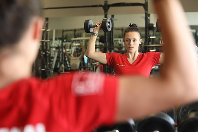 Carolyn Kurnizki, personal training lead at Chico Sports Club, does overhead presses in the weight room on Dec. 31. (Carin Dorghalli -- Enterprise-Record)