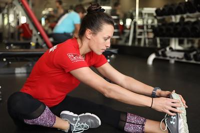 Personal training lead at Chico Sports Club, Carolyn Kurnizki, stretches in the weight room on Dec. 31. (Carin Dorghalli -- Enterprise-Record)