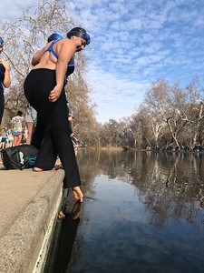 """Tania Miranda, of Chico, tests the icy water with a tentative toe at One Mile in lower Bidwell Park in Chico Wednesday morning, in the annual """"Polar Bear"""" plunge. (Robin Epley -- Enterprise-Record)"""