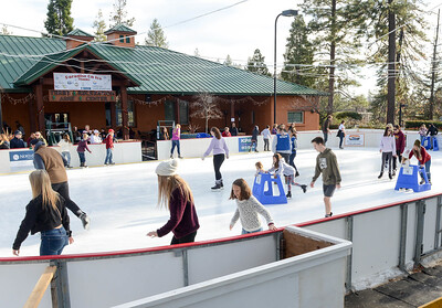 Skaters circle around on Dec. 28 at the Paradise Ice Rink at the Terry Ashe Recreation Center in Paradise. (Matt Bates -- Enterprise-Record)
