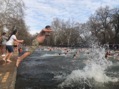 """Swimmers dive into the icy waters at One Mile in lower Bidwell Park in Chico Wednesday morning in the annual """"Polar Bear"""" plunge. (Robin Epley -- Enterprise-Record)"""