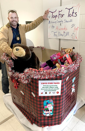 KEVIN HARVISON | Staff photo<br /> Pittsburg County Sheriff Chris Morris is captured in a photo with the Toys For Tots drop box located at the PIttsburg County Sheriffs Department. Pittsburg County Sheriffs Department has partnered with Atwoods to collect toys till December 15.
