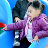KEVIN HARVISON | Staff photo<br /> JEnjoying the nice December weather, Joseph Adams follows Braya Wilson down a slide.