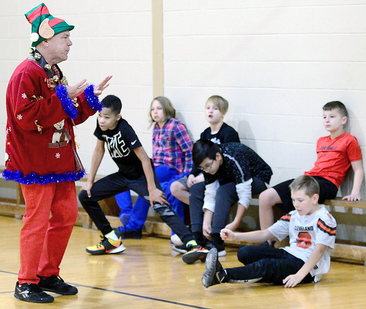 KEVIN HARVISON | Staff photo<br /> Parker Intermediate Center teacher Brent Grilliot gives a pep talk to his team before the start of the PIC school wide Dodge Ball Tournament Thursday at the school's gymnasium.