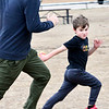 KEVIN HARVISON | Staff photo<br /> Ben Webster chases his son Blake Webster as the two play a game of football during a stop back to their home in Joplin, Mo.