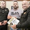 KEVIN HARVISON | Staff photo<br /> McAlester Police Department presents citizen Cody Davis with a certificate of Appreciation for exemplary service and deeds. Pictured from left, MPD Warner Bedford, Cody Davis and Lt. Bobby Cox.