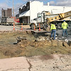 KEVIN HARVISON |<br /> A McAlester city crew works to repair Second Street between Wyandotte and Cherokee Avenues after a sink hole developed in the road.