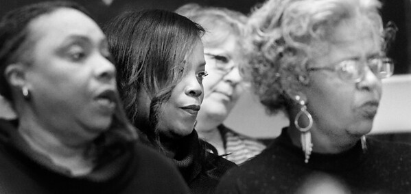 KEVIN HARVISON |<br /> Members of the Pittsburg County Holiday Commission Unity Choir listen before the start of Friday's  Dr. Martin Luther King Jr. Commemorative Ceremony at Mount Triumph Missionary Baptist Church.