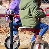 KEVIN HARVISON | Staff photo<br /> Jefferson Early Childhood Center student Chandler Johnson, left and school mate rests after peddling a piece of playground equipment.