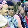 KEVIN HARVISON | Staff photo<br /> Emerson Elementary Students react before the start of the schools annual Christmas Program at S. Arch Thompson Auditorium Monday night.