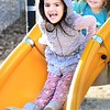 KEVIN HARVISON | Staff photo<br /> Phoenix Rodgers face shows the enjoyment she gets as she goes down a slide whle enjoying the warmer than ususal temperatures.