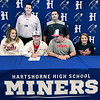 KEVIN HARVISON | Staff photo<br /> Hartshorne Miner Sean Horstman signs a letter to play baseball for Seminole Junior College Wednesday at the Hartshorne Public School Library. Pictured seated from left, Jaime Horstman, Sean Horstman, Scott Horstman and Jessah Horstman; and back row, Jason Lindley Hartshorne Superintendant and Justin James Hartshorne Head Baseball Coach.
