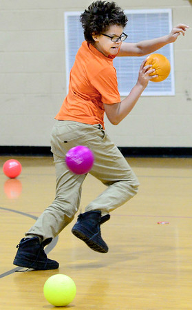 KEVIN HARVISON | Staff photo<br /> The last man standing for his team, a Parker Intermediate Center student attempts to out run a ball during a school wide Dodge Ball Tournament Thursday with the winning team getting a match with the PIC teachers team Friday morning.