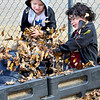 KEVIN HARVISON | Staff photo<br /> Jefferson Early Childhood Center students, facing camera from left, Kingston Rhine and Braylon Hernandez participate in a leaf war while on a recent recess.