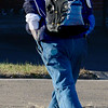 KEVIN HARVISON | Staff photo<br /> Unidentified man crosses Carl Albert Parkway while wearing a backpack.
