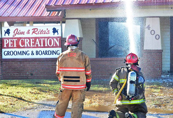 KEVIN HARVISON   Staff photo<br /> A fire destroyed Pet Creation at 400 West Carl Albert Parkway Friday morning.