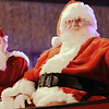 KEVIN HARVISON | Staff photo<br /> Mr. and Mrs. Claus makes an appearnance during the McAlester annual Christmas Paradae Thursday night.