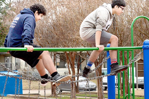 KEVIN HARVISON | Staff photo<br /> Pictured from left, Jesus Bravo-Mendez and Eddi Piedra practice a American Ninja course the two set up while hanging out at Chadick Park.