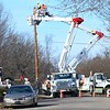 KEVIN HARVISON | Staff photo<br /> Public Service of Oklahoma cres work on a line Wednesday at the corner of Wichita Avenue and Fifth Street.
