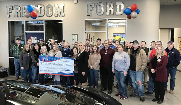 KEVIN HARVISON |<br /> Sam Wampler's Freedom Ford presented a check to the McAlester Regional Health Center Foundation to help fund the MRHC Tower that is expected to house Cancer Center and Surgury Department. Freedom Ford raised money from sells and service mid October through December for the Former Freedom Ford employee Rusty Kyle. Freedom Ford wanted to bring Cancer Awareness the stores forefront with the Rusty Kyle Memorial Fund. Members of Kyle's family traveled from Oklahoma City to be on hand for the check presentation.