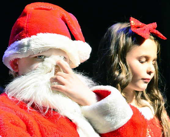 KEVIN HARVISON | Staff photo<br /> Luke Thomas, left, tries to get a little breathing room while wearing the Santa costume in The Greatest Snowman presented by the Will Rogers Elementary Scool recently.