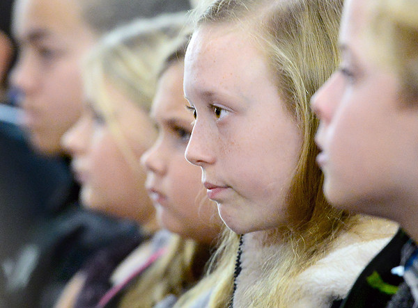 KEVIN HARVISON |<br /> McAlester Public School students listen to the Dr. Martin Luther King Jr. ceremony at the Mount Triumph Missionary Baptist Church Friday.
