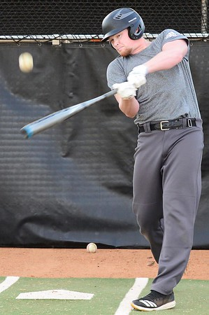 KEVIN HARVISON | Staff photo<br /> McAleser senior Cade Lott takes a cut during batting practice for the McAlester Buffaloes Wednesday at Mike Deak Field.