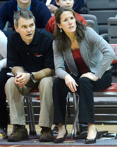 WARREN DILLAWAY / Star Beacon NANCY BARBO, Geneva girls basketball coach, and assistant Jon Barbo watch the action on Saturday afternoon during a home game with Lakeside.