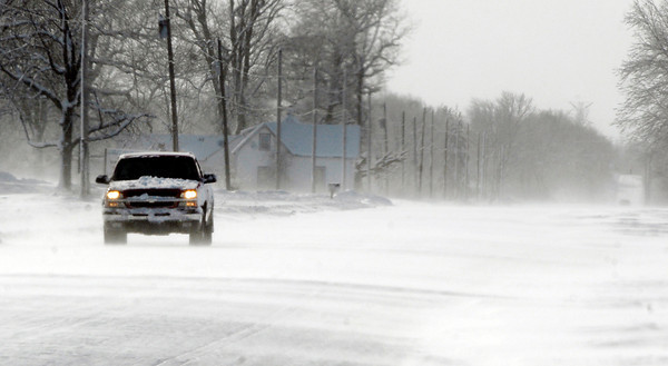 THB photo/John P. Cleary<br /> This motorist makes their way along County Road 200 East as the strong winds blew the snow across the outlying roads causing them to drift and reducing visibility.