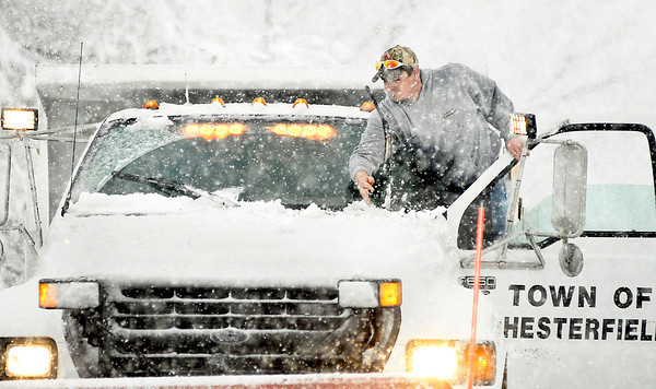 THB photo/John P. Cleary<br /> Brent Reid, of the Town of Chesterfield, pauses with his snow plow to clean off his wiper blades as plow drivers tried to keep up with the constantly falling snow.