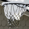 THB photo/John P. Cleary<br /> Sunday's falling wet snow couldn't escape this basketball net as it held the snow in it's narrowing grasp.
