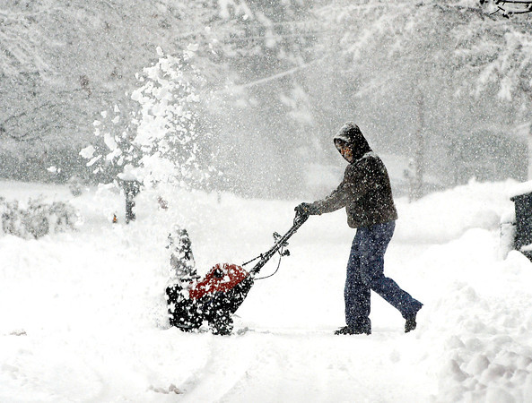 THB photo/John P. Cleary<br /> heavy wet snow fell over the area bringing out the  snow blowers as people tried to keep up with the constantly falling flakes all day long.