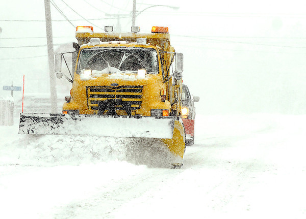 THB photo/John P. Cleary<br /> This State Highway plow makes it's way through the snow along SR 32.