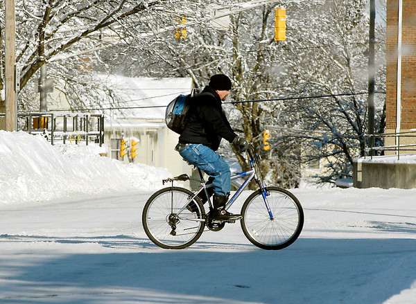 THB photo/John P. Cleary<br /> This man found the best mode of transportation after all the snow and cold was his bicycle as he pedaled his was east along  West 10th Street in Anderson Tuesday morning.